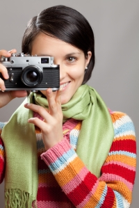 smiling woman taking a picture