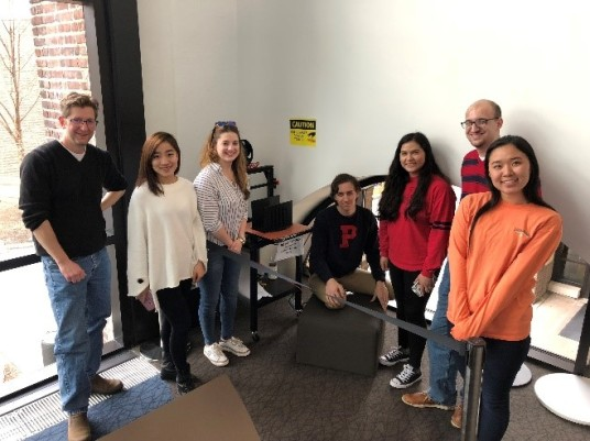 THAR130 class standing in front of the gMax printer with the 3D print of their stage