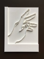 3D print of a hand on a backing